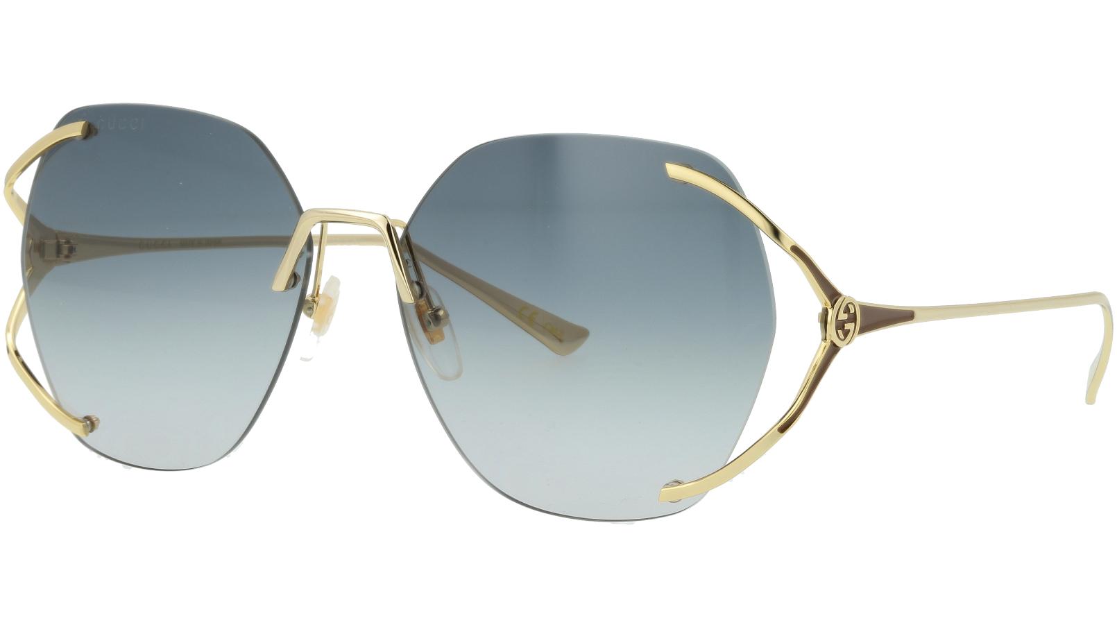Gucci GG0651S 002 59 Gold Oval Sunglasses